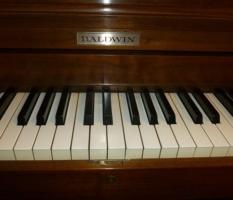 Baldwin walnut studio upright piano